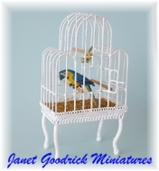 Dolls House Parrot in a Cage.